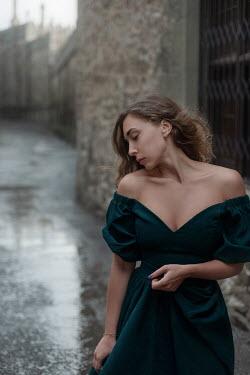 Tatiana Mertsalova SERIOUS WOMAN WITH GREEN DRESS IN STREET