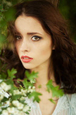 Klaudia Rataj SERIOUS BRUNETTE GIRL BY TREE IN BLOSSOM OUTDOORS