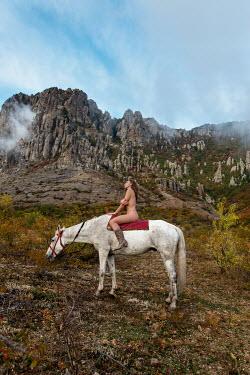 Tatiana Mertsalova NAKED WOMAN ON WHITE HORSE BY MOUNTAIN