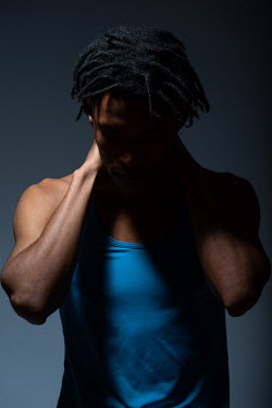 Magdalena Russocka young man in blue tight vest in shadow inside