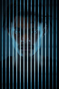 Magdalena Russocka young man behind glass with verical stripes