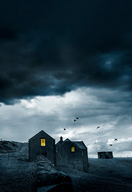 Stephen Mulcahey LIGHTS IN COTTAGE WINDOW WITH STORMY SKY
