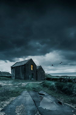 Stephen Mulcahey OLD BUILDING BY SEA WITH STORMY SKY