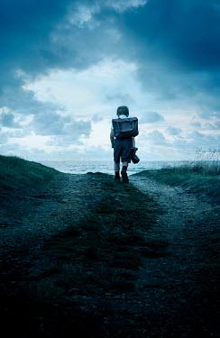 Stephen Mulcahey LITTLE SCHOOLBOY WALKING ON COASTAL PATH
