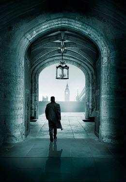 Stephen Mulcahey MAN WALKING THROUGH ARCHED BUILDING IN LONDON