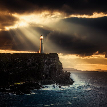 Evelina Kremsdorf LIGHTHOUSE ON CLIFF BY SEA WITH SUNLIGHT