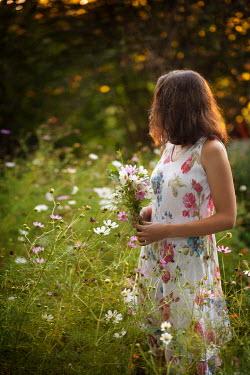 Kerstin Marinov BRUNETTE GIRL IN FIELD PICKING FLOWERS