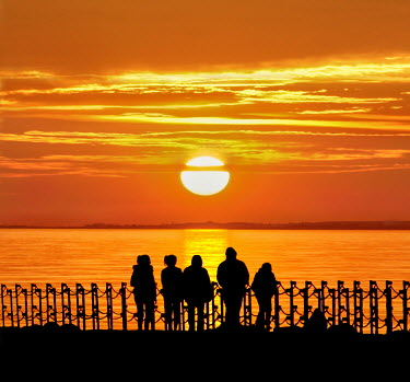 Adrian Leslie Campfield SILHOUETTED PEOPLE WATCHING LAKE AT SUNSET