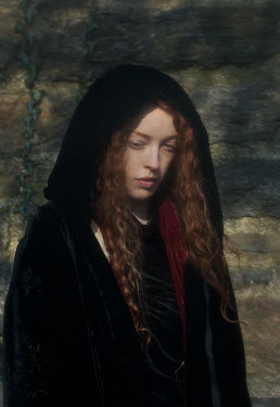 Daniel Murtagh WOMAN WITH RED HAIR AND CAPE BY STONE WALL