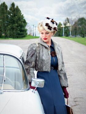 Elisabeth Ansley BLONDE RETRO WOMAN STANDING BY CAR