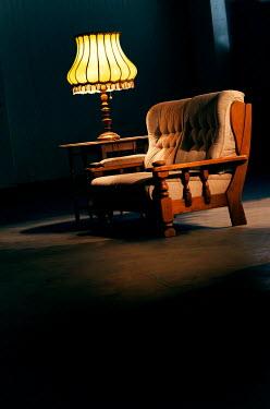 Ute Klaphake SOFA AND LAMP IN ROOM AT NIGHT