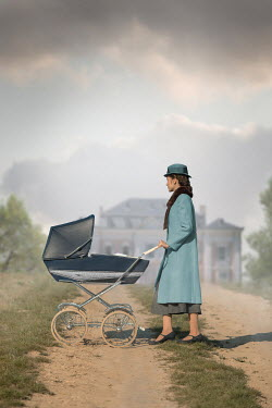 Ildiko Neer Vintage woman with pram by house