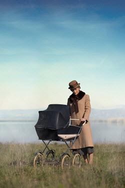 Ildiko Neer Vintage woman with pram by lake