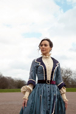 Miguel Sobreira HISTORICAL BRUNETTE WOMAN STANDING IN PARK