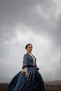 Miguel Sobreira HISTORICAL BRUNETTE WOMAN IN WINTRY LANDSCAPE