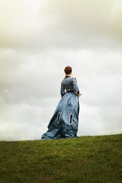 Miguel Sobreira HISTORICAL BRUNETTE WOMAN STANDING IN FIELD