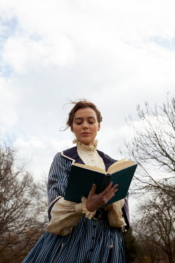 Miguel Sobreira HISTORICAL WOMAN STANDING IN PARK READING BOOK