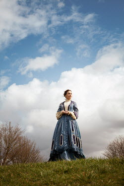 Miguel Sobreira HISTORICAL BRUNETTE WOMAN STANDING ON HILL