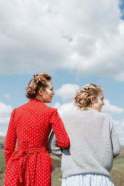 Shelley Richmond TWO RETRO WOMEN ARM IN ARM IN COUNTRYSIDE