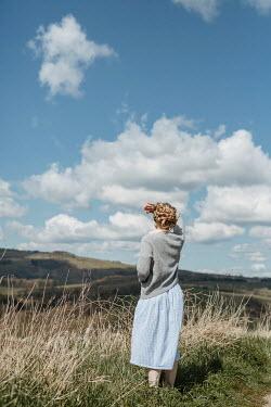 Shelley Richmond RETRO WOMAN STANDING WATCHING COUNTRYSIDE