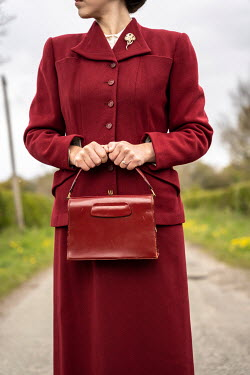 CollaborationJS RETRO WOMAN IN RED SUIT ON COUNTRY ROAD