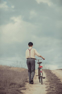 Ildiko Neer Retro man with bicycle on country road
