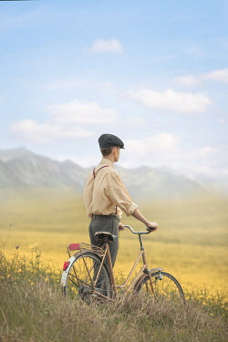 Ildiko Neer Retro man with bicycle in meadow