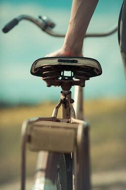 Ildiko Neer Close up of retro man with bicycle
