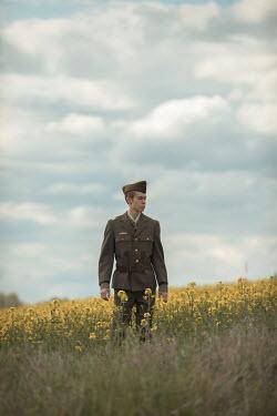 Ildiko Neer Wartime soldier walking in meadow