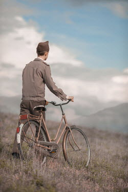 Ildiko Neer Wartime soldier walking with bicycle