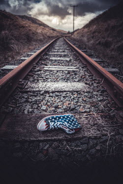 Marie Carr AMERICAN SNEAKER LYING ON RAILWAY TRACK
