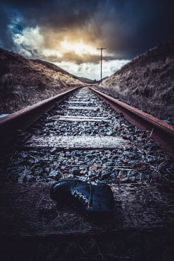Marie Carr BOOT LYING ON RAILWAY TRACK AT DUSK