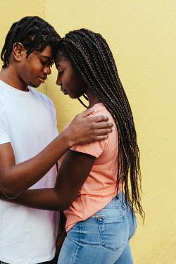 Matilda Delves YOUNG COUPLE EMBRACING OUTDOORS