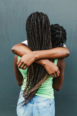 Matilda Delves YOUNG CONTEMPORARY COUPLE HUGGING OUTDOORS