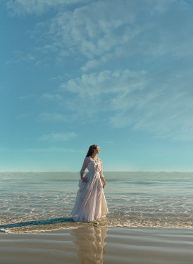 Mary Wethey WOMAN IN WHITE DRESS STANDING IN SEA