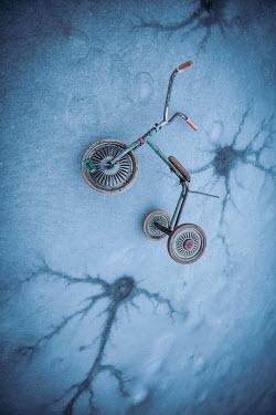 Natasza Fiedotjew child's tricycle on cracked ice
