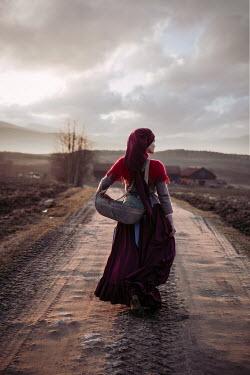 Natasza Fiedotjew peasant woman walking on country road