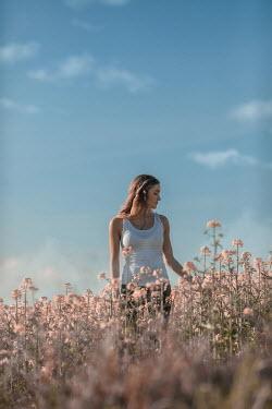 Ildiko Neer Young woman standing in meadow