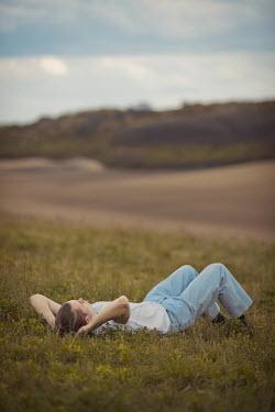 Ildiko Neer Young man relaxing on meadow