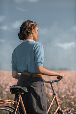 Ildiko Neer Close up of vintage woman with bicycle