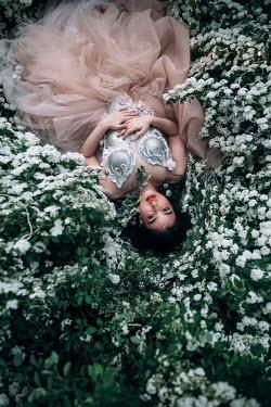 Jovana Rikalo WOMAN IN SILVER BODICE LYING ON FLOWERS