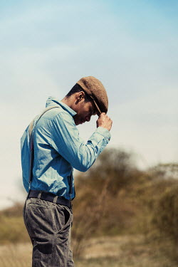 Magdalena Russocka young vintage man standing in countryside
