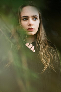 Shelley Richmond SERIOUS GIRL WITH LONG BROWN HAIR BY TREE