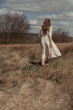 Shelley Richmond BRUNETTE GIRL WITH WHITE DRESS WALKING IN FIELD