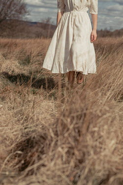 Shelley Richmond GIRL WITH WHITE DRESS WALKING IN FIELD