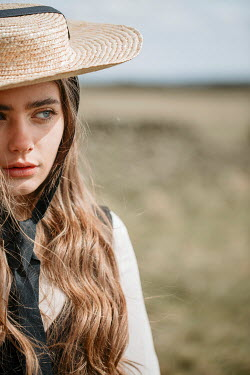Shelley Richmond SERIOUS GIRL WITH LONG HAIR AND HAT IN FIELD