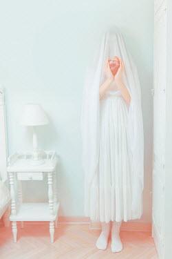 Tijana Moraca WOMAN IN WHITE VEIL HOLDING HERAT INDOORS