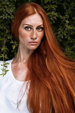 Tijana Moraca WOMAN WITH LONG RED HAIR AND FRECKLES OUTDOORS