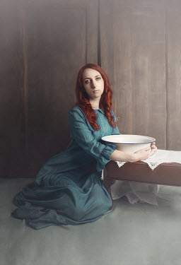 Anna Buczek WOMAN WITH RED HAIR SITTING HOLDING BOWL