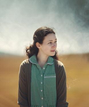 Anna Buczek BRUNETTE GIRL IN GINGHAM DRESS OUTDOORS